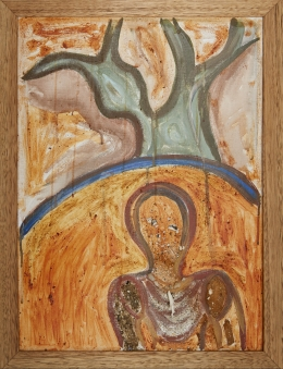 An artwork in a wooden frame depicting a person in front of a tree