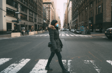 Young woman crossing street