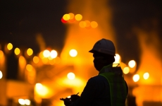 Night time silhouette of an industrial plant worker