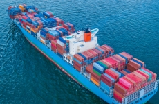 Aerial view of international cargo ship carrying goods