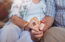 ageing couple holding hands
