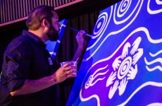 ahri_launch-92_artist_dennis_golding_works_on_the_painting_pathways_to_our_right.jpg