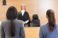 anonymous women face a female judge in a courtroom