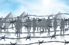 asylum_seekers_behind_barbed_wire