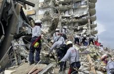 collapsed apartment building in miami with rescue crew