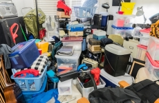 Personal possessions almost stacked to the ceiling of a house