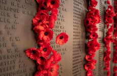 Poppy decoration next to the wall of fallen soldiers at the Australian War Memorial