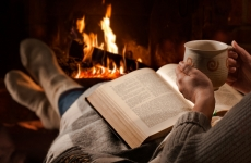 reading_in_front_of_a_fireplace