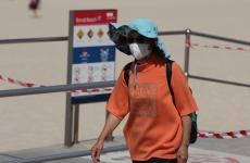 woman wearing a face mask at Bondi beach