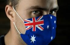 A man's face with an Australian flag mask