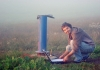 Dr Gabriel Rau downloads groundwater data from a bore