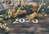Celebrating the new year with 2020 on a wooden background.