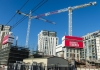 Two cranes shown in an area of Sydney where apartments are being constructed