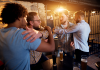 Picture of men fighting in a bar