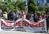 People protesting refugee policy
