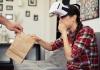 Woman feeling nauseous while wearing a virtual reality headset