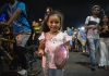 Girl holding saucepan in cacerolazo protest