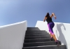 A woman runs up an outdoor staircase