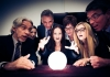 people look in amazement at a crystal ball