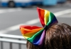 person with a rainbow bow in hair