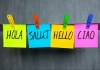 post-it notes experssing greetings in different languages