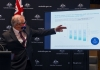prime minister scott morrison points to modelling information at a press conference