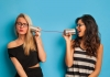 Women on tin can phones