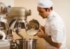Young baker mixing dough