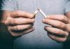 hand crushing cigarette