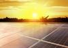 golden sun shines across solar panels on a roof
