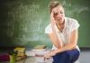 teacher in classroom feeling stressed