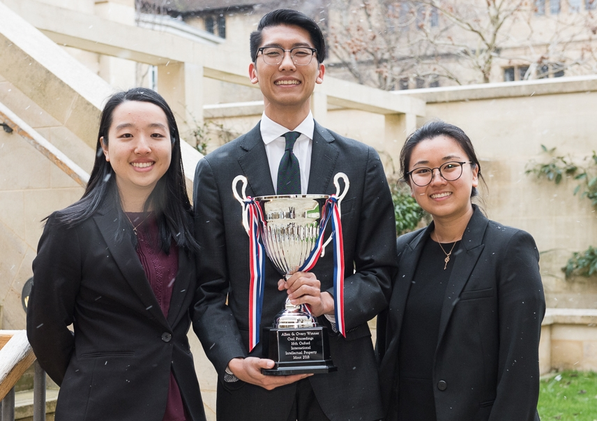 UNSW Law students Anne Wang, Wee-An Tan and Christina Han with their trophy. Photo: Edmund Blok