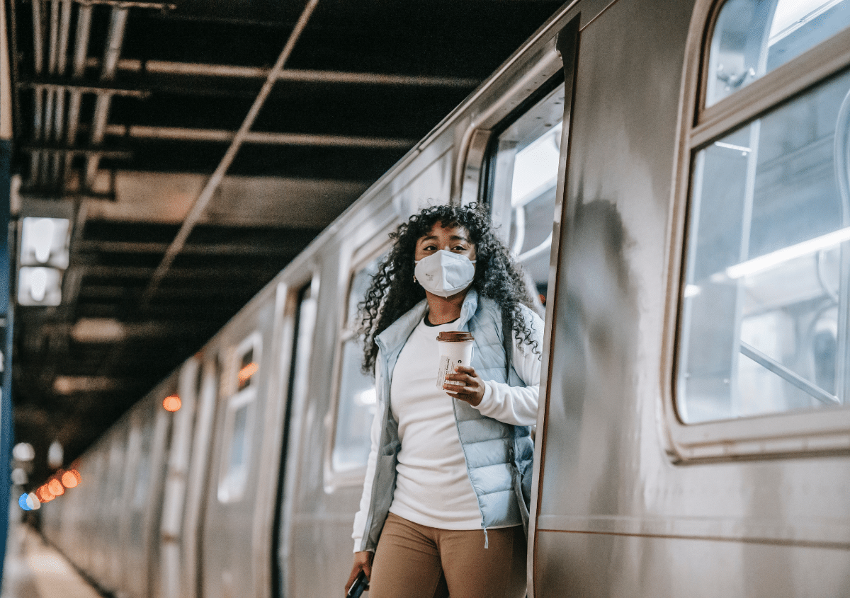 Woman on subway with mask