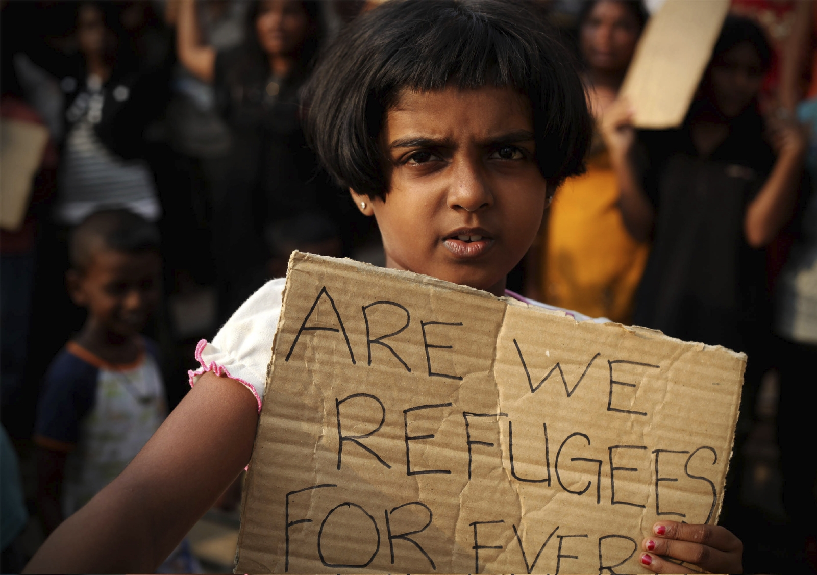 A Sri Lankan asylum seeker holds a placard during a protest. Photo IStock