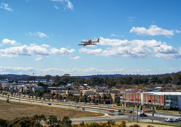 Drone delivery at scale will transform the skies, change expectations for speedy delivery, and hide the labour that makes it possible. Photo: Wing