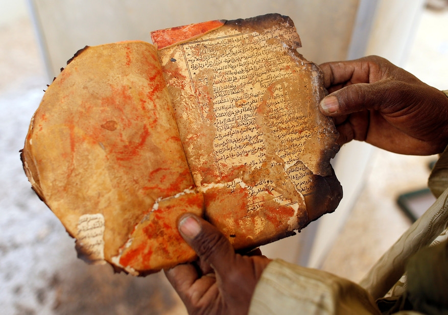 A burnt ancient manuscript at the Ahmed Baba Centre for Documentation and Research, in Timbuktu. Benoit Tessier/Reuters