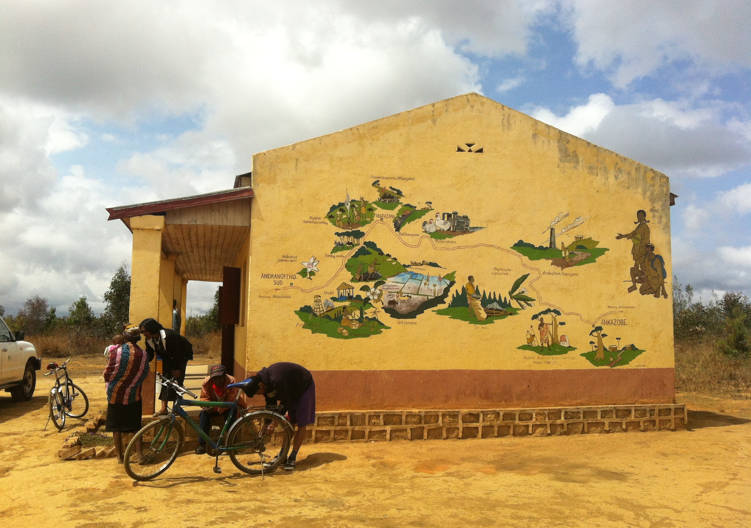 Some teachers, students and their bikes outside a school in Madagascar