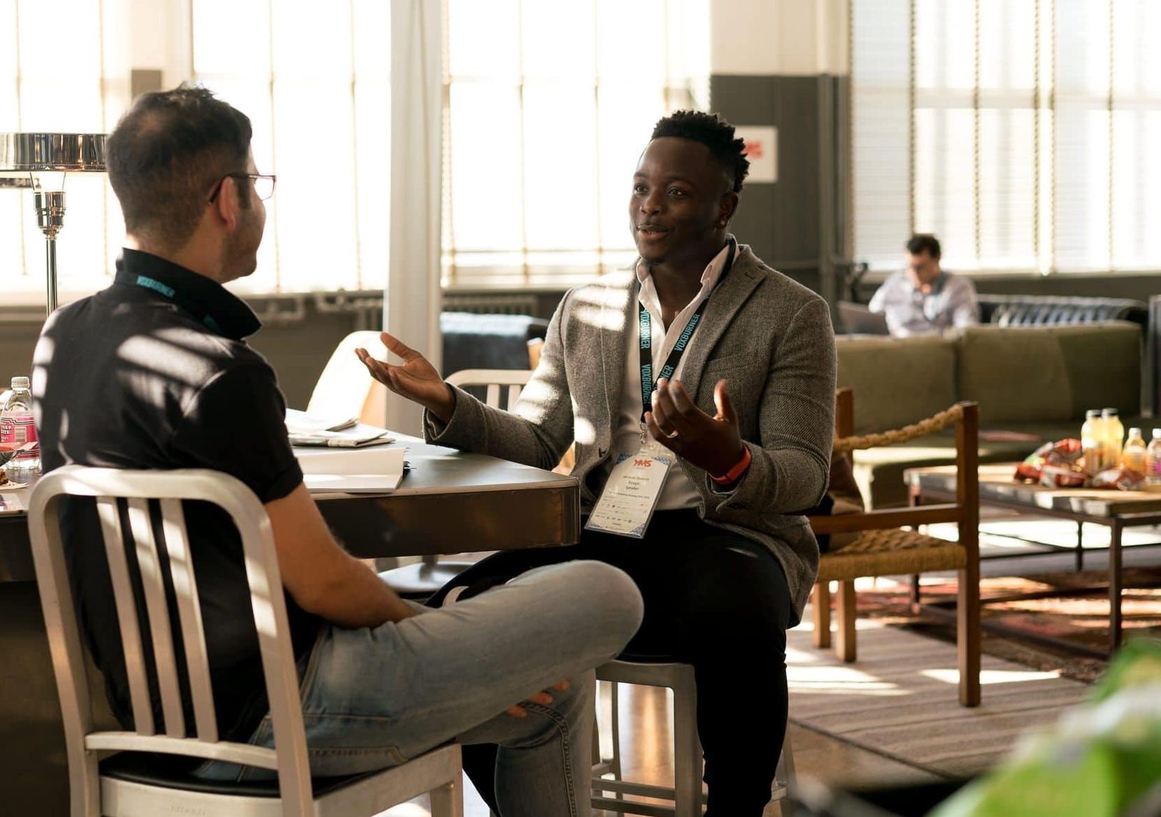 Men having conversation at work.