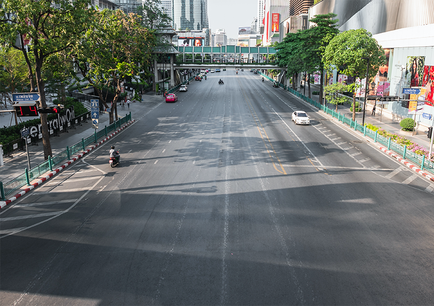 An empty road in downtown Bangkok, following the government's decision to close all markets and shopping malls to combat the COVID-19 outbreak.  Image: Shutterstock.