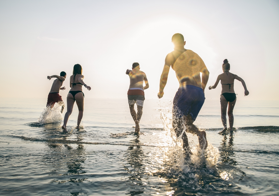 Teenagers having fun on the beach